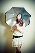 Young Woman In 70S Hippie Style Posing Looking Up With Umbrella