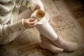 Woman With Cup Of Coffee On Vintage Carpet