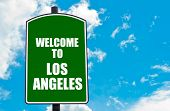 image of blue angels  - Green road sign with greeting message WELCOME TO LOS ANGELES isolated over clear blue sky background with available copy space - JPG