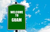 picture of guam  - Green road sign with greeting message WELCOME TO GUAM isolated over clear blue sky background with available copy space - JPG