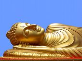 picture of recliner  - Golden Reclining Buddha face in blue sky - JPG