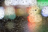 stock photo of raindrops  - raindrops on the glass at evening - JPG