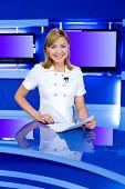 Television Anchorwoman At Tv Studio