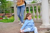 foto of disobedient  - Naughty Girl 2 years old sitting on the ground - JPG