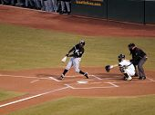 White Sox Juan Pierre Makes Contact With Ball With As Kurt Suzuki Catching