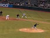 White Sox Pitcher Mark Buehrle Throws Pitch With A's Daric Barton Taking Lead From First Base
