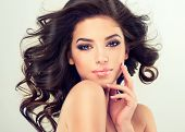 Beautiful girl model with long brown curled hair poster