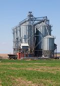 foto of silos  - Industrial silos under blue sky - JPG