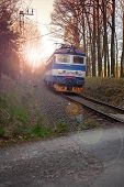 picture of train track  - Train on railway tracks in the Czech republic at sunset - JPG