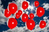 image of bahrain  - many ballons in colors of bahrain flag flying on sky - JPG