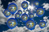 image of nebraska  - many ballons in colors of nebraska flag flying on sky - JPG