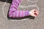 stock photo of strangle  - Dead woman laying on asphalt - JPG