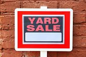 image of yard sale  - Wooden Yard Sale sign on red brick wall background - JPG