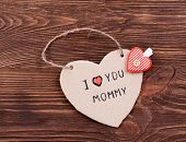 picture of mummy  - Inscription I LOVE YOU MUMMY on cutout carton on wooden background - JPG