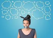 stock photo of taboo  - Funny person with taped mouth and hand drawn clouds around head - JPG