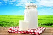 image of milk glass  - Retro can for milk and glass of milk on wooden table - JPG