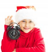 picture of santa claus hat  - little girl in Santa Claus hat holding alarm clock showing twelve o - JPG