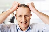 picture of pulling hair  - Frustrated mature man pulling his hair - JPG