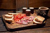 pic of vodka  - Bacon tomato bread and vodka on wooden board - JPG