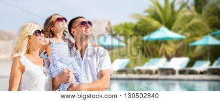 summer holidays, travel, tourism, vacation and people concept - happy family over hotel resort swimm