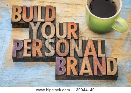 build your personal brand - motivational concept in vintage letterpress wood type block with a cup o