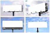 Set of 4 blank big billboards over blue sky, put your own text here