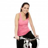 stock photo of athletic woman  - Attractive brunette woman with bike - JPG
