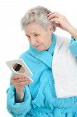 Senior Woman Looks In A Mirror
