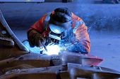 foto of welding  - industrial welding being carried out on a piece of mining equipment - JPG