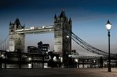 The famous landmark of London: the Tower Bridge and the Themes by night.