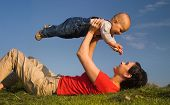 Baby and his mother are having outdoor fun together and they are smiling a lot. There are nice after