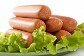 foto of hot dogs  - appetizing pork sausages seasoned by green salad - JPG