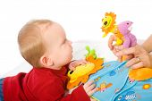 Baby boy (6 months old) playing with soft toys. Toys are property released.