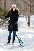 Smiling Woman Shoveling Snow