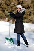 Cute Woman Shoveling Snow