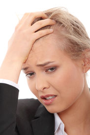 stock photo of sad face  - Young business woman with headache - JPG