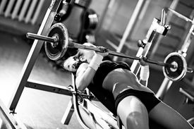 picture of weight-lifting  - Young woman weight training - JPG