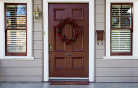 picture of front door  - Home burgundy door with wreath with two white trimed blinded windows - JPG