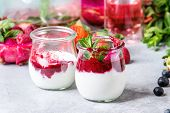 Jars Of Natural White Yogurt With Berry Sauce, Fruit Salad With Pink Dragon Fruit, Berries And Mint, poster