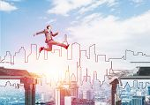 Businessman Jumping Over Gap In Concrete Bridge As Symbol Of Overcoming Challenges. Sunlight And Cit poster