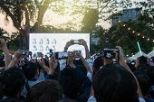 Fan Club People Taking Photographs By Smart Phone During Music Entertainment Public Concert Outdoor  poster