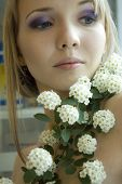 Beauty girl with white flowers