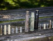 Varied Of Used Gun Shell Ammunition Casings. Sport Target Shooting Spent Casing. poster