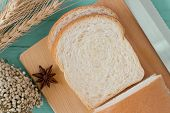 Sliced Soft And Sticky Delicious White Bread On Wood Cutting Board. Prepare Sliced Bread For Breakfa poster