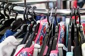 Hangers With Clothes In A Fashionable Clothing Boutique Close-up. Shopping Clothing Concept. Things  poster