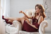 Beautiful Sexy Lady In An Elegant Burgundy Dress. Close Up Fashion Portrait Of Model Indoors. Beauty poster