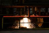 Cutting Steel Machine In Smelting Steel Plant. Processing Of Forming Deformed Bars Steel. poster