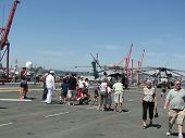 Civilians Inspect A Ch-53E Sea Stallion Helicopter,an  Mv-22 Osprey, And A Sh-60 Seahawk