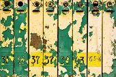 Close Up Shot Of Old Weathered Colorful Iron Mailboxes poster