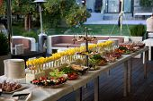 Buffet Served Table With Snacks, Fruits, Canape, Sweets And Appetizers.catering Event Plate Service. poster